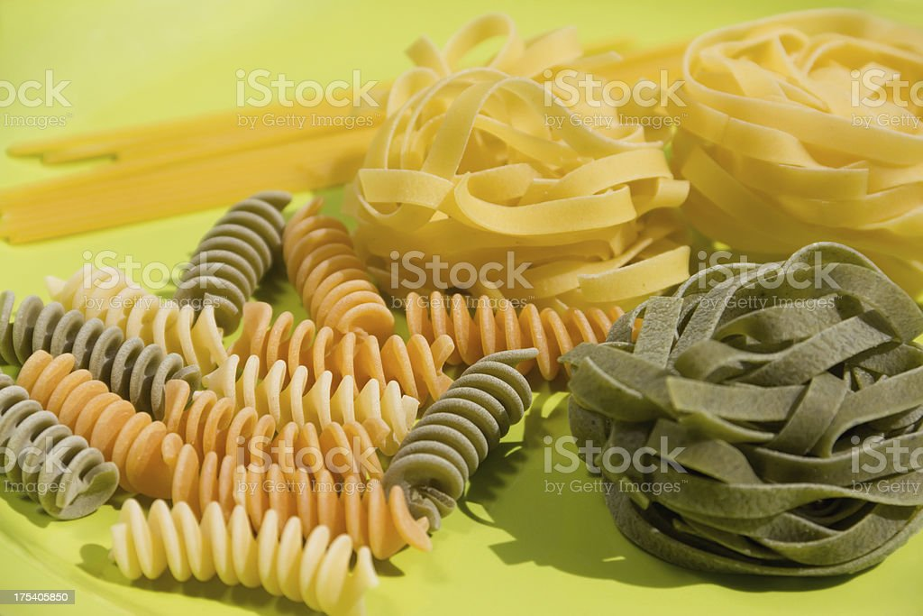 colorful pasta on green plate royalty-free stock photo