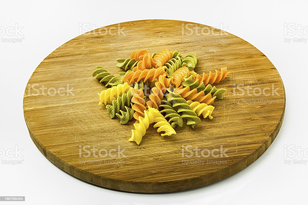 Colorful Pasta on Wooden Cutting Board royalty-free stock photo