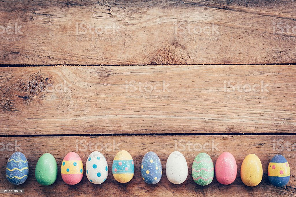 Colorful pastel easter eggs on wooden background stock photo