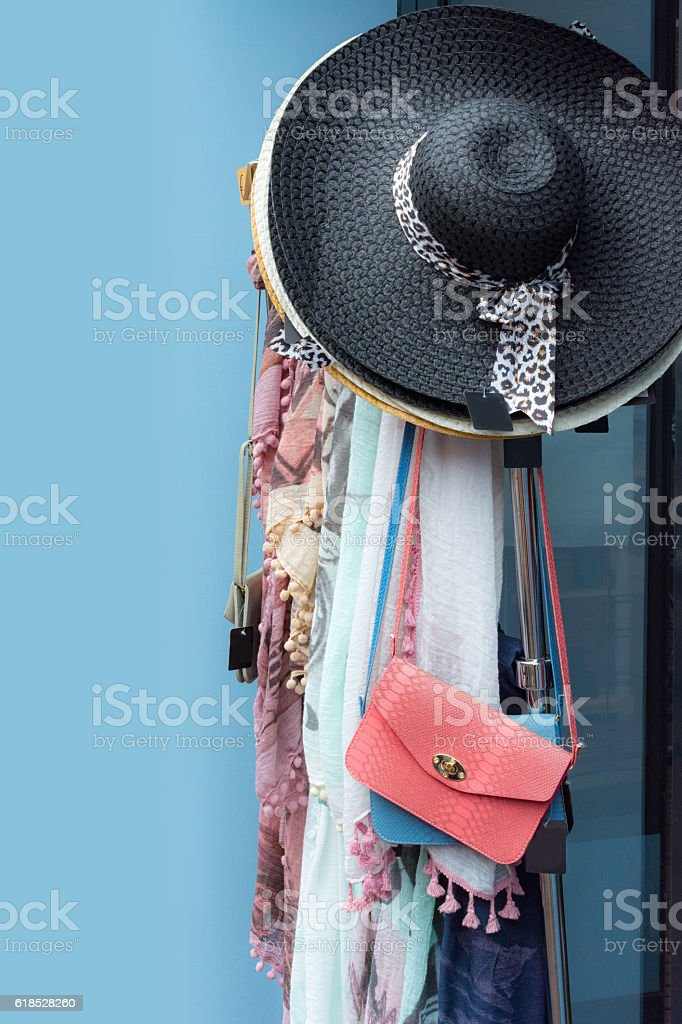 Colorful patterned scarfs, hats and handbags stock photo
