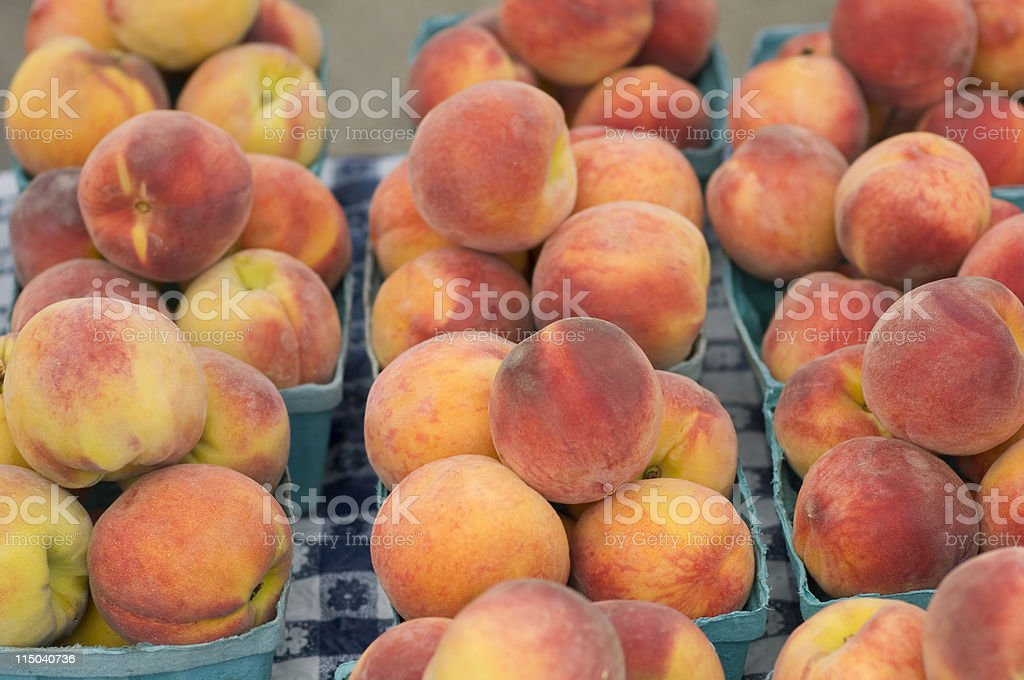 Colorful Peaches in Several Small Baskets on a Table stock photo
