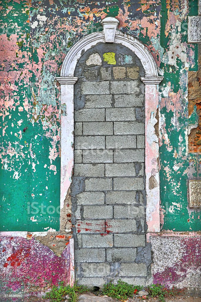 Colorful, Peeling, grungy door in abandoned building stock photo