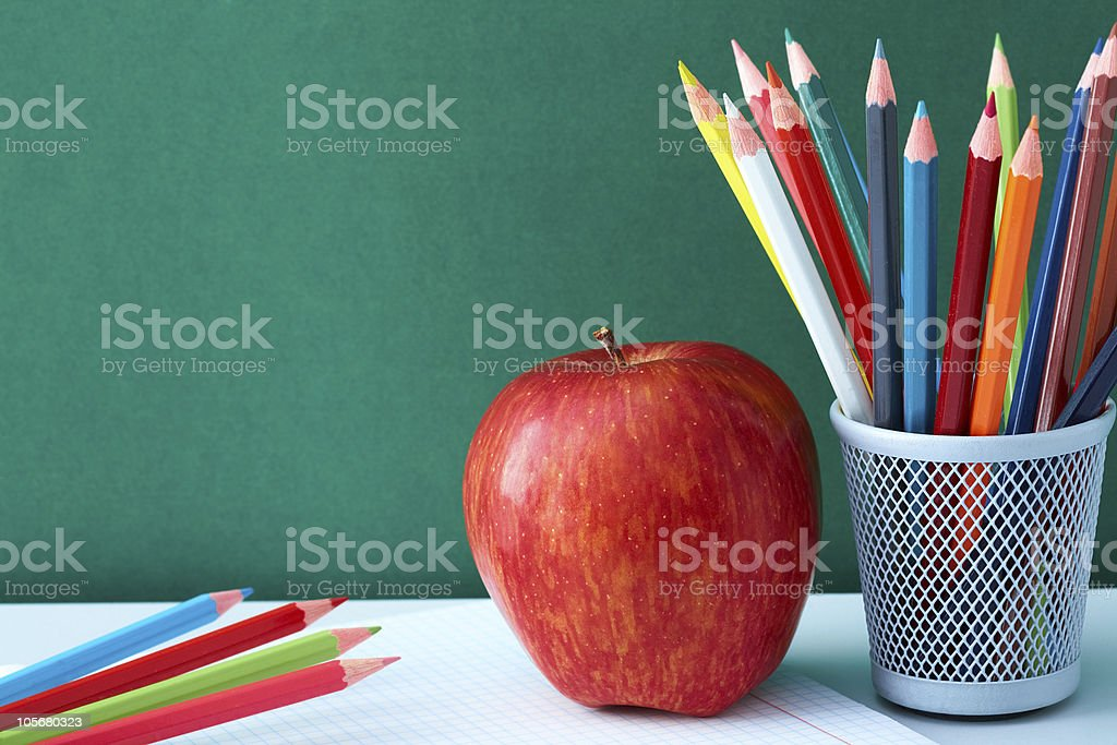 Colorful pencils and apple royalty-free stock photo