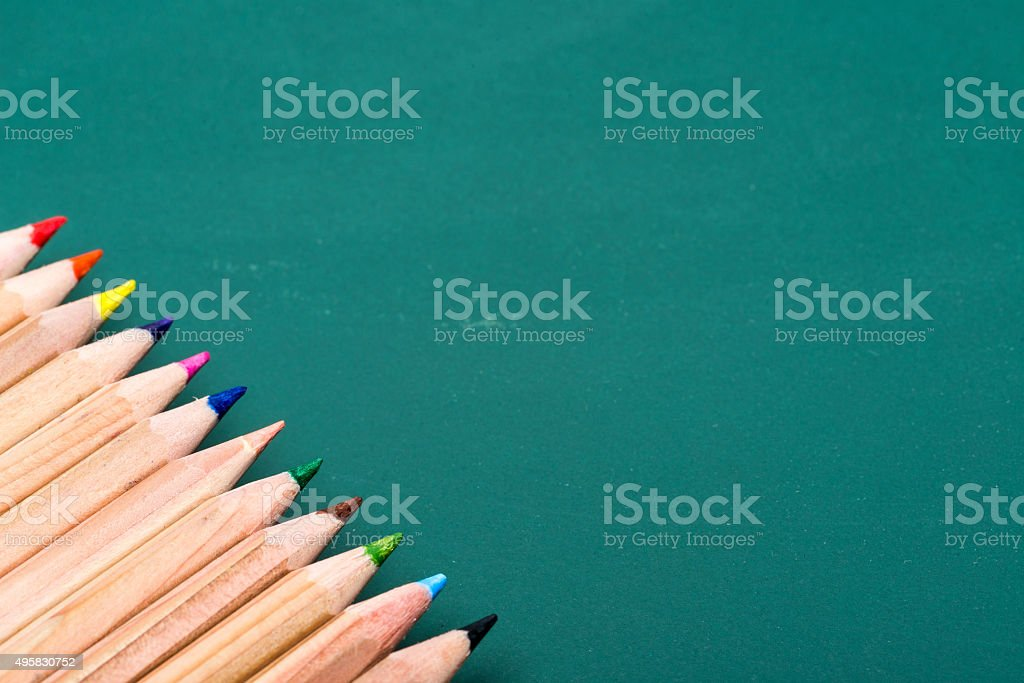 colorful pencils on board stock photo