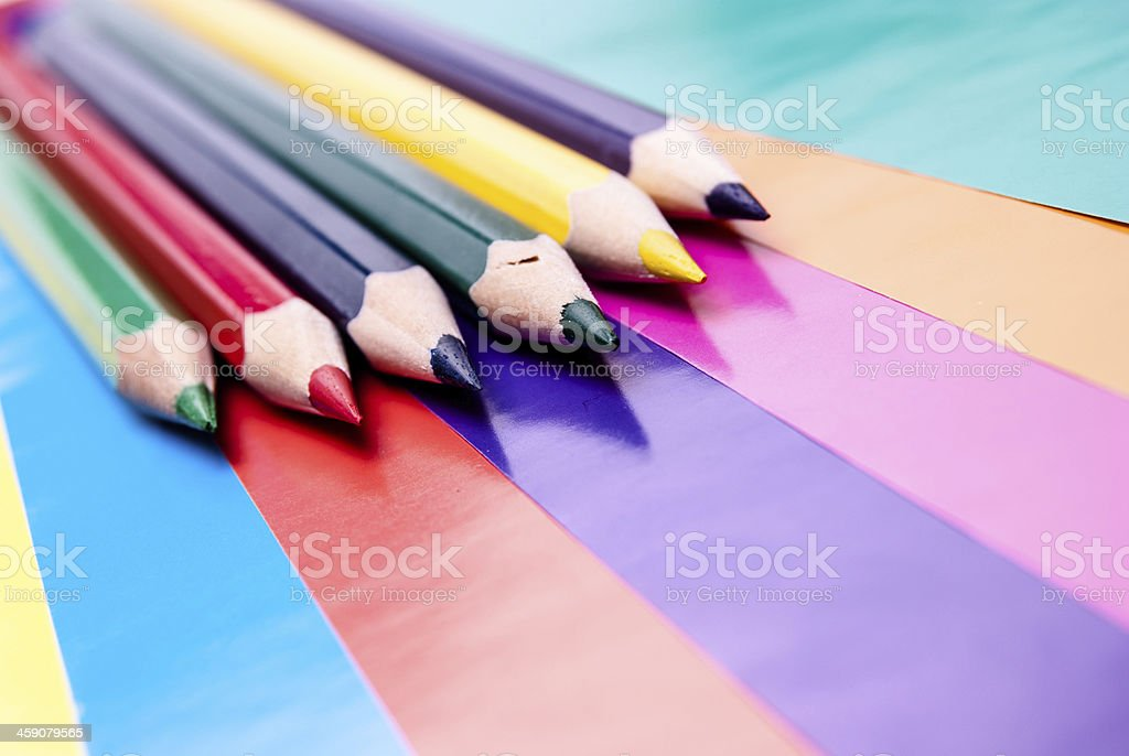 Colorful pencils on colored paper royalty-free stock photo