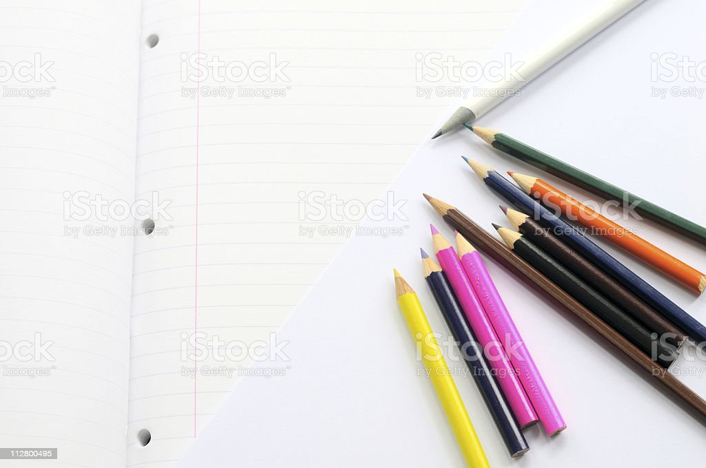 Colorful pencils on white paper royalty-free stock photo