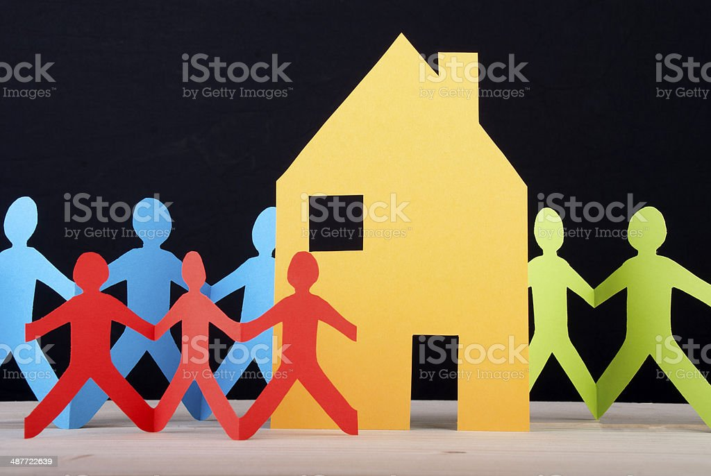 Colorful People and a House stock photo