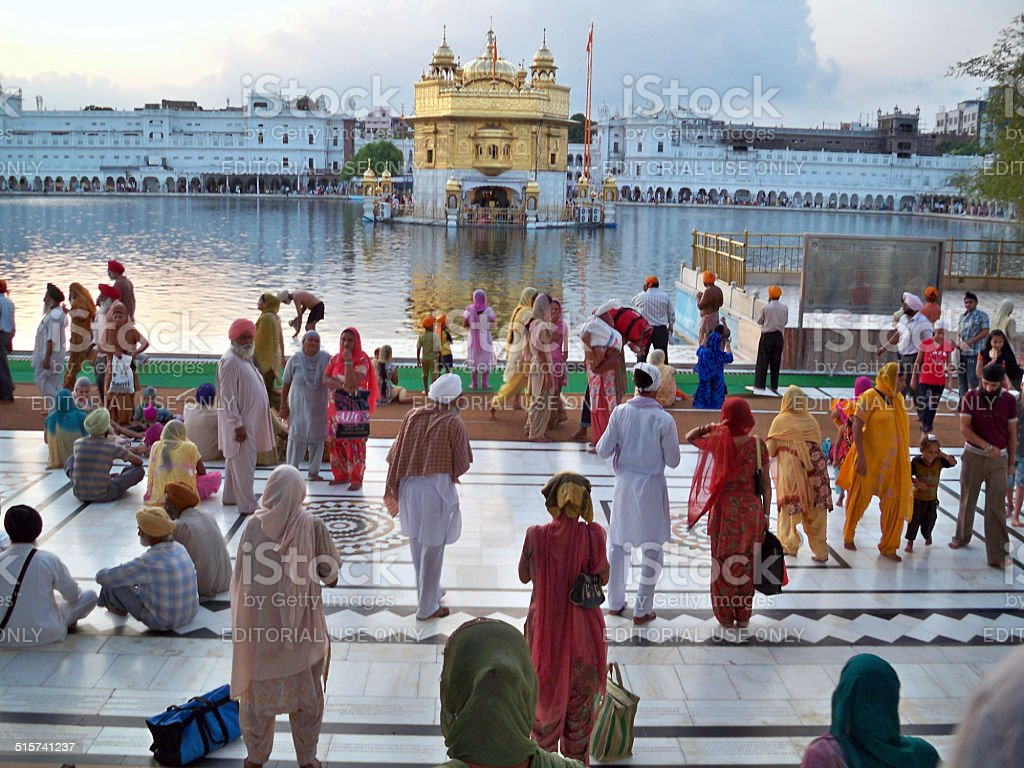 Colorful people at Golden Temple in Amritsar, India stock photo