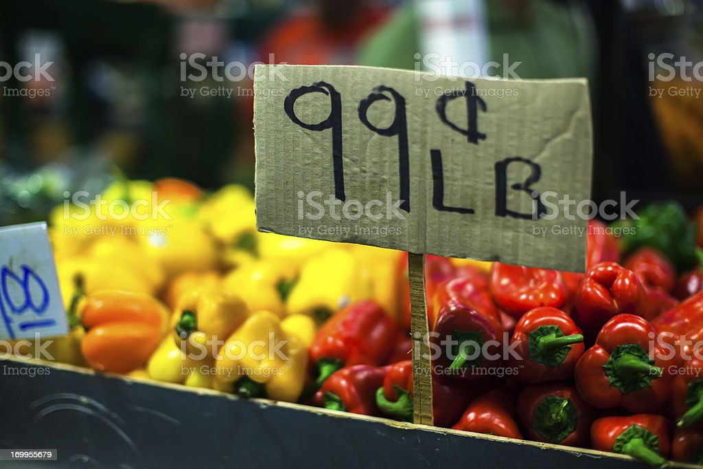 Colorful Peppers 99¢ Per Pound royalty-free stock photo