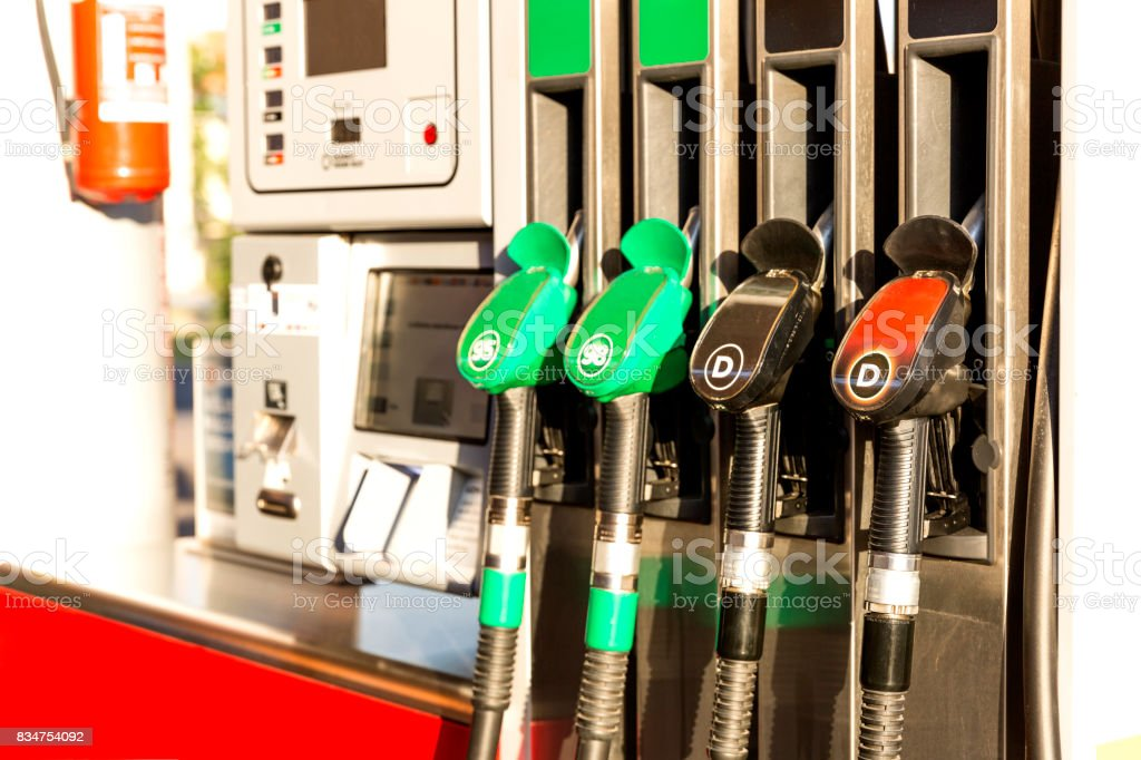 Colorful Petrol pump filling nozzles. Gas station in a service in daytime stock photo