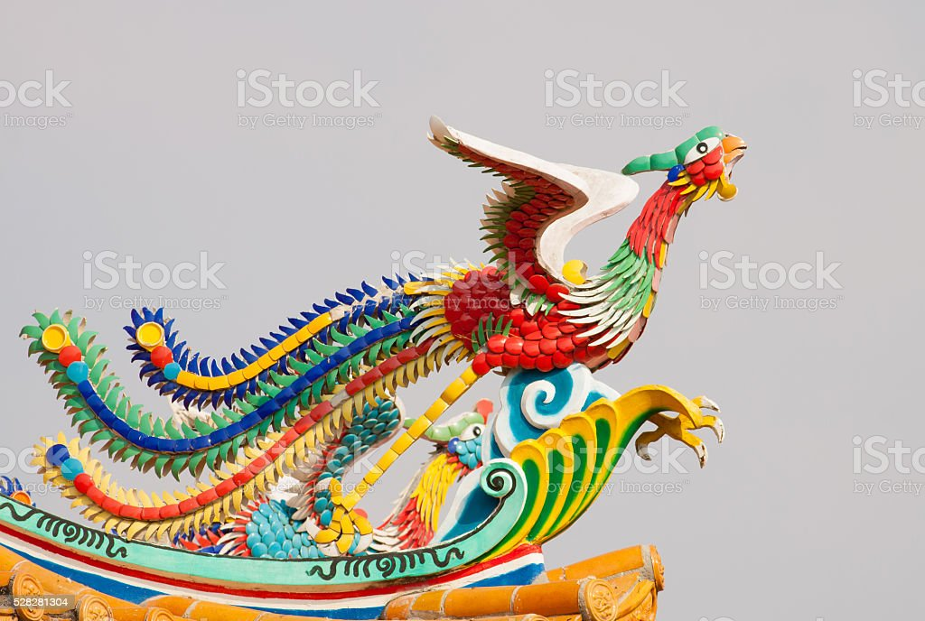 Colorful pheasant statue on roof royalty-free stock photo