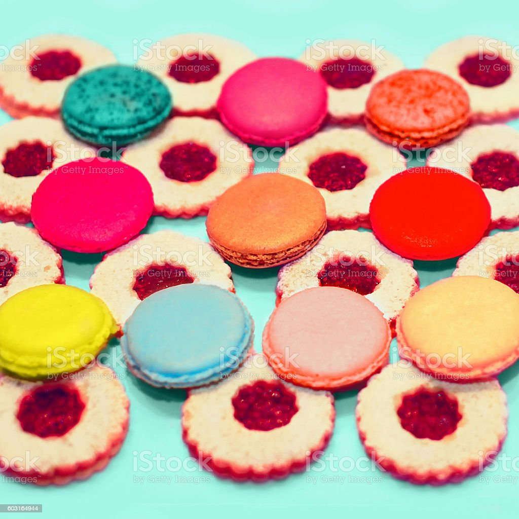Colorful photo sweet macaroons and berries cakes on the table stock photo