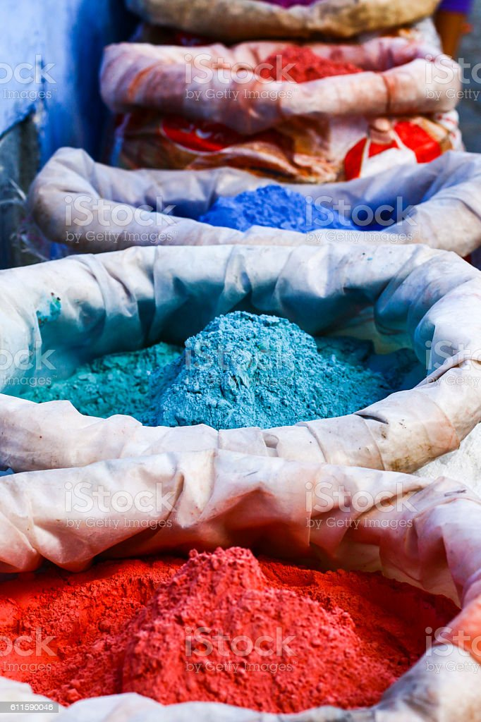 Colorful pigments. Moroccan colors. Colored powders at market. stock photo