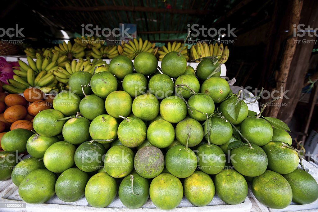 Colorful Pile of Limes in Cambodian Market royalty-free stock photo