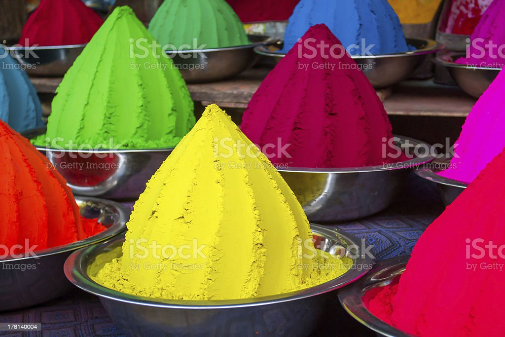 Colorful piles of powdered dyes stock photo