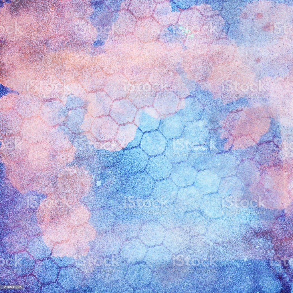 Colorful pink and blue hand painted background with honeycomb texture stock photo
