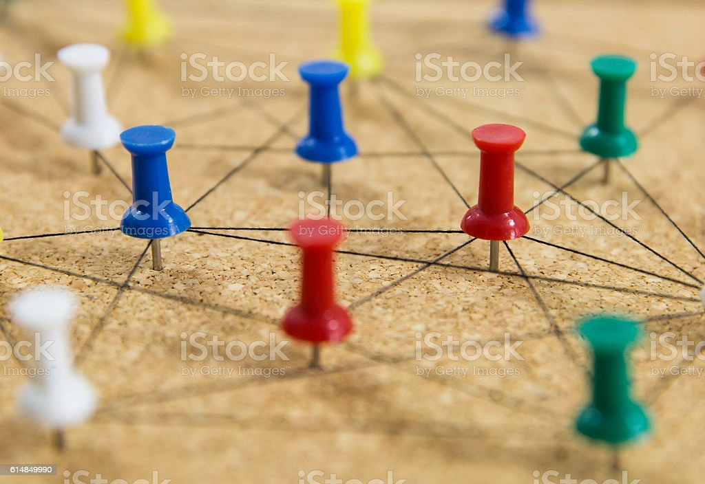colorful pins on board, connection concept stock photo