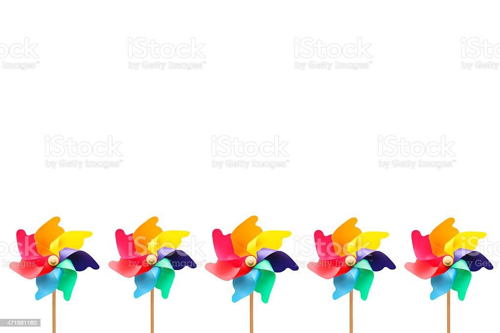 Colorful Pinwheels Frame on White Background stock photo
