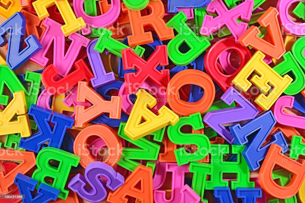 Colorful plastic alphabet letters as background stock photo