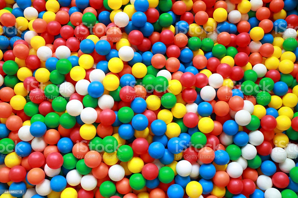 Colorful plastic balls in ball pit stock photo