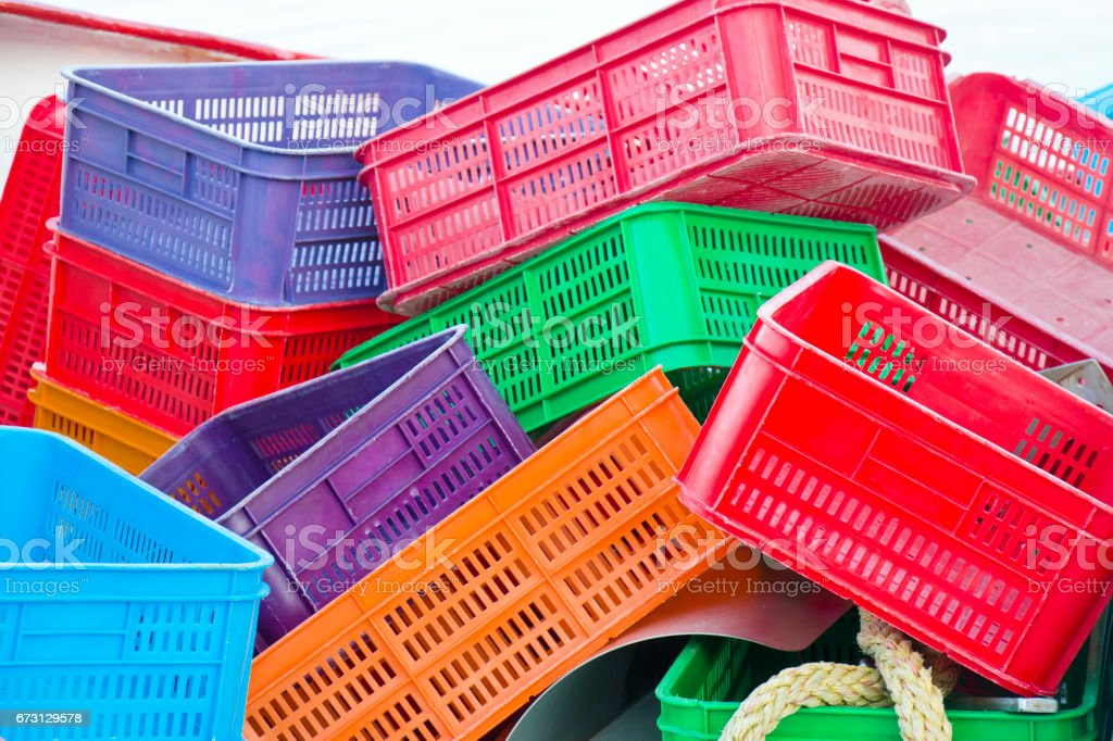 Colorful plastic baskets stock photo
