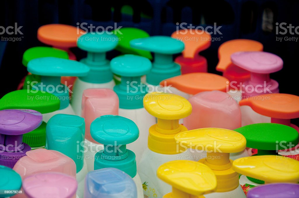 colorful plastic caps for detergents , shampoos and liquid soaps stock photo