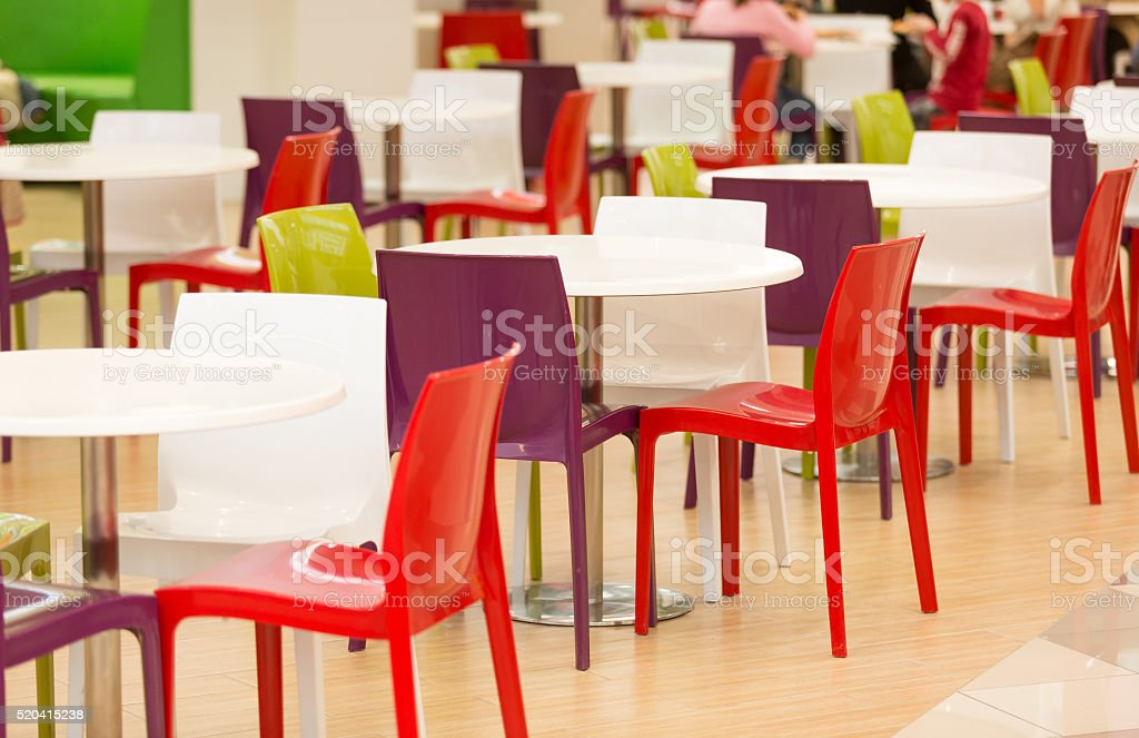 Colorful plastic chairs and tables in canteen stock photo