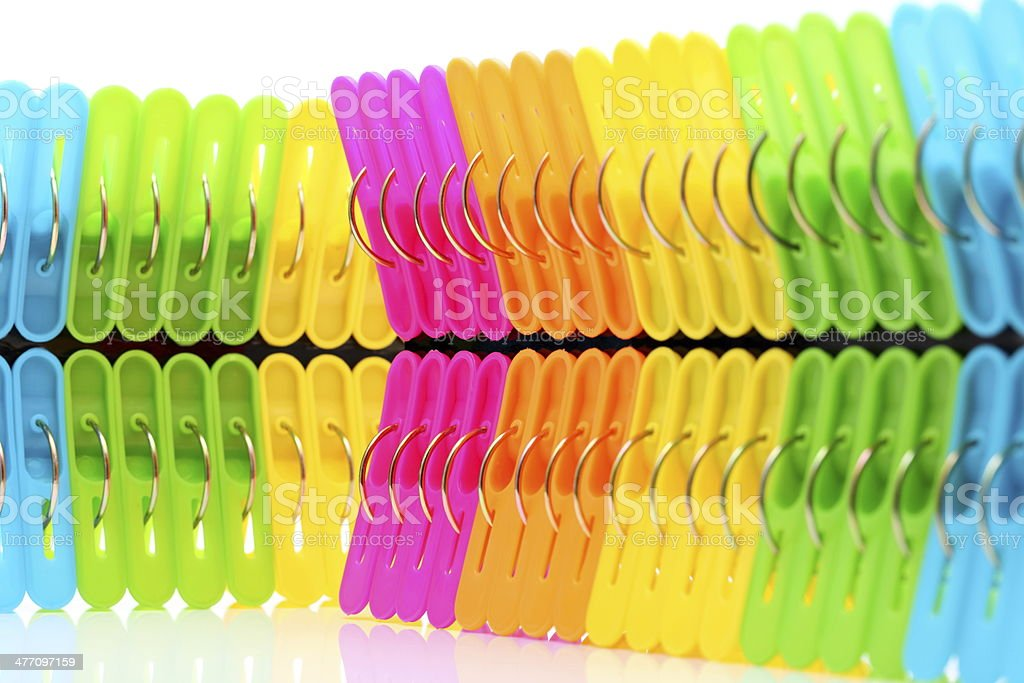 Colorful plastic clothespins stock photo