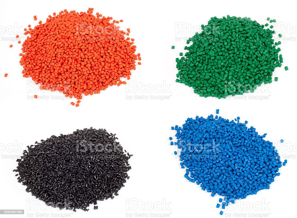 colorful plastic polymer granules stock photo