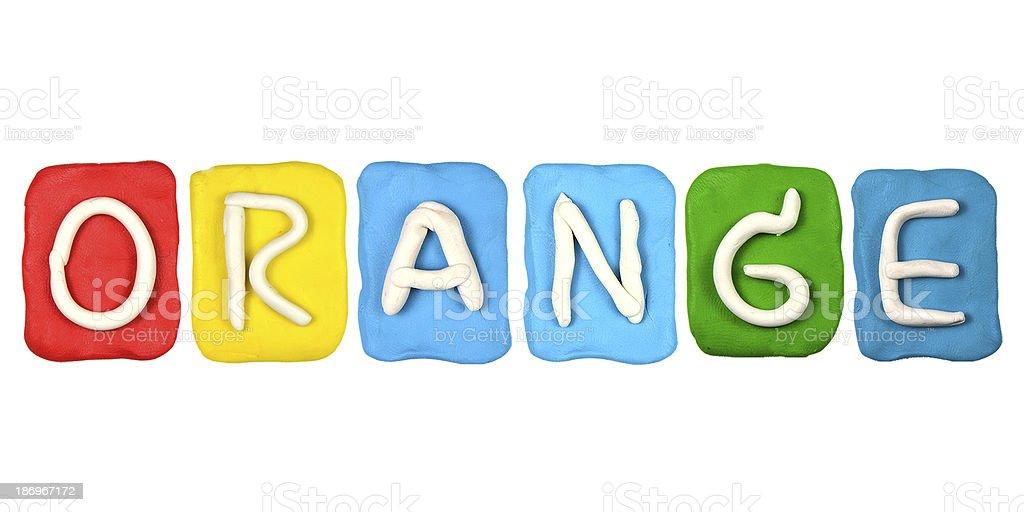 Colorful plasticine alphabet form word ORANGE royalty-free stock photo