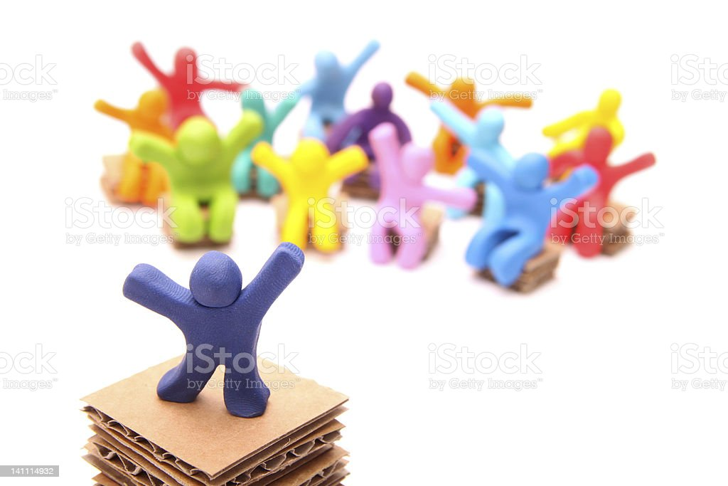 Colorful plasticine person on podium with group royalty-free stock photo