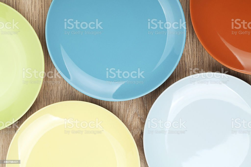 Colorful plates and saucers stock photo