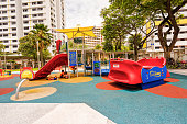 Colorful playground on yard at HDB apartment in Singapore