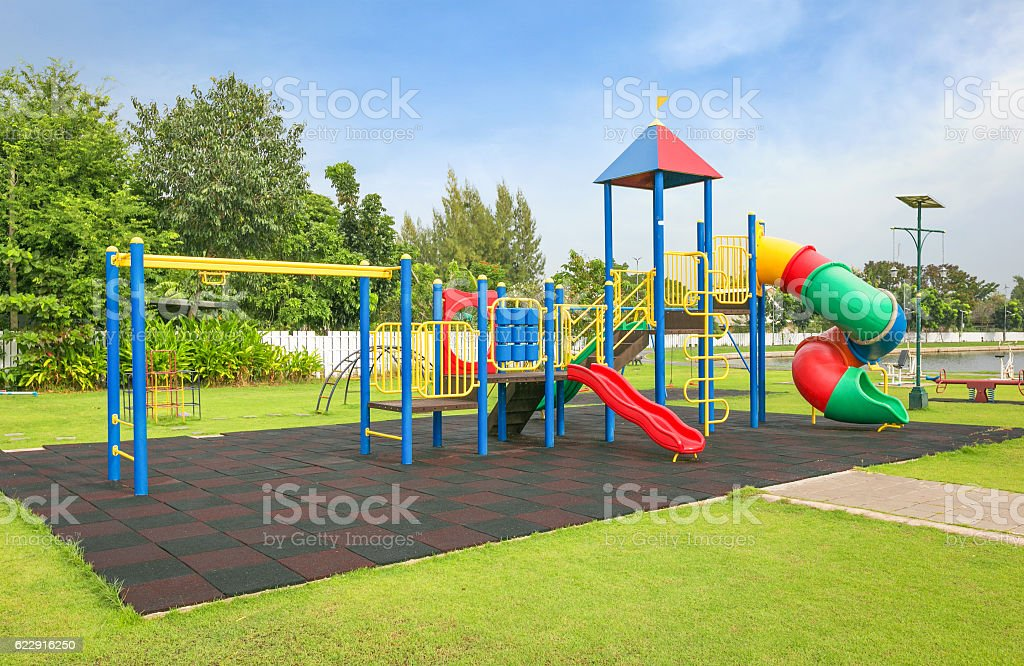 Colorful playground on yard in the park. stock photo