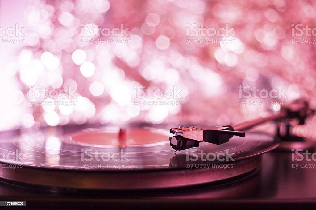 Colorful playing vintage gramophone with blurred blackground stock photo
