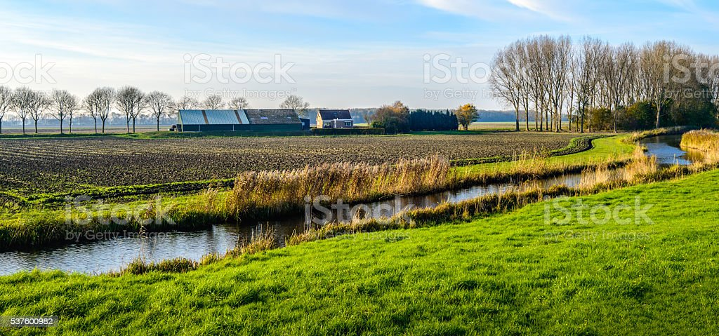 Colorful polder landscape with meandering stream stock photo