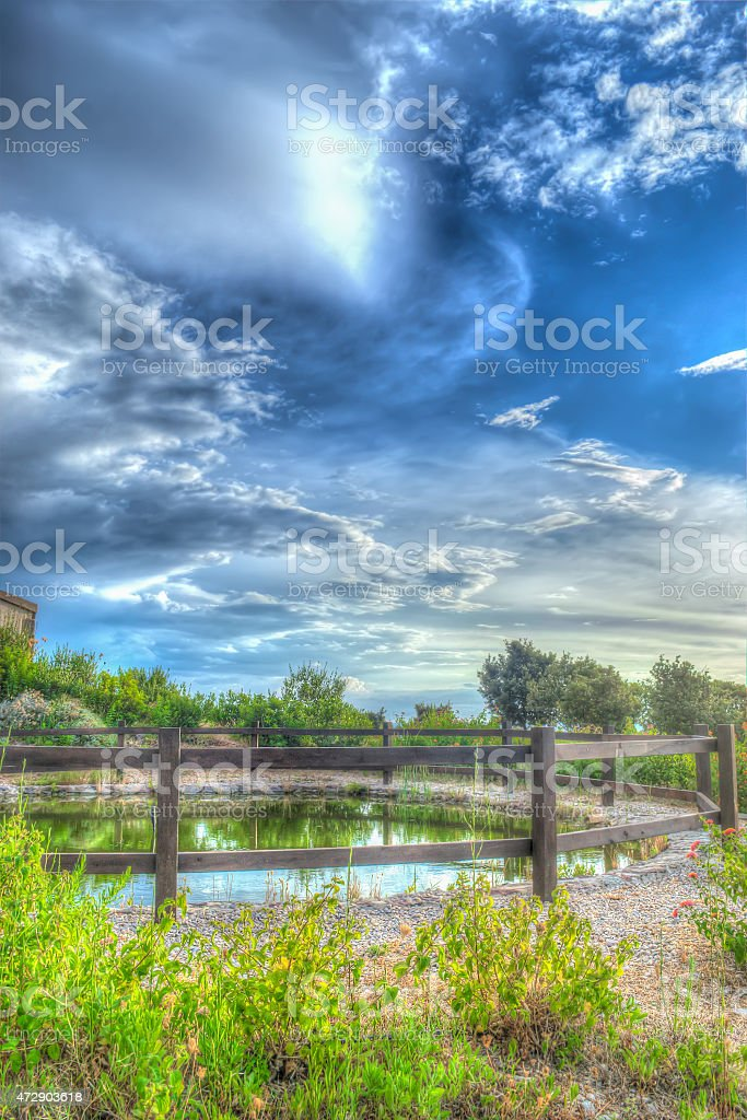 colorful pond by the sea in Sardinia stock photo