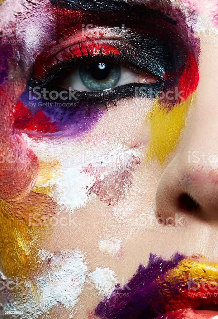Colorful portrait of neon painting over fashion model face. stock photo
