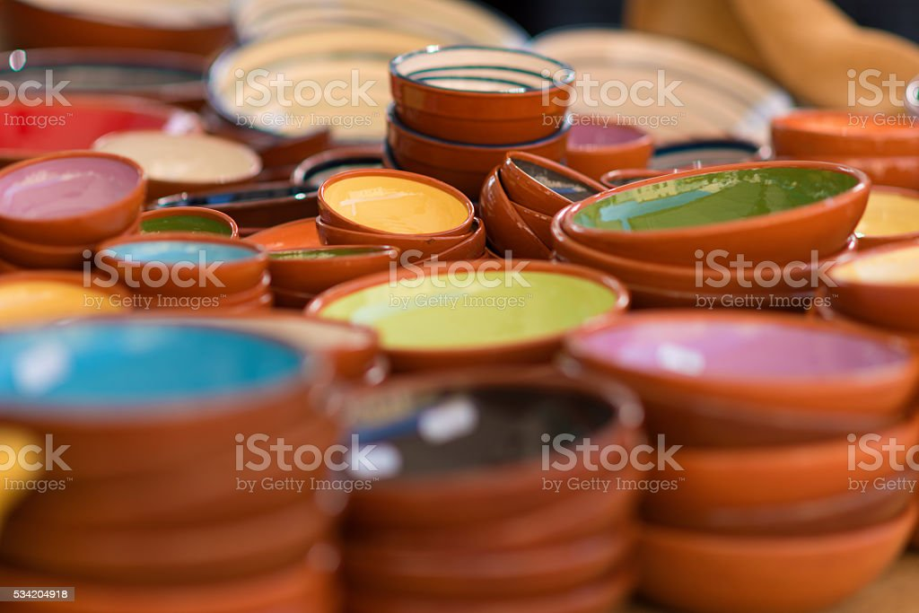 colorful pottery dishs on a market stall stock photo