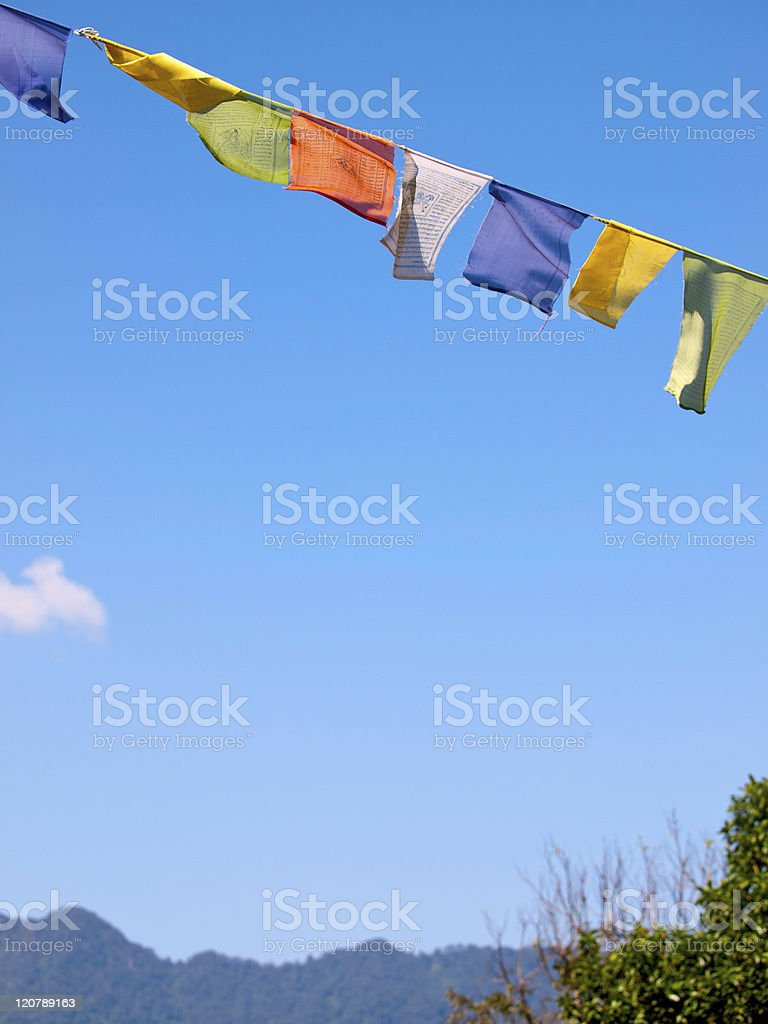 Colorful prayer flags over a clear blue sky stock photo