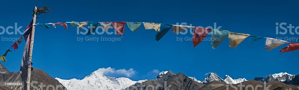 Colorful prayer flags traditional buddhist shrine Everest NP Himalayas Nepal stock photo
