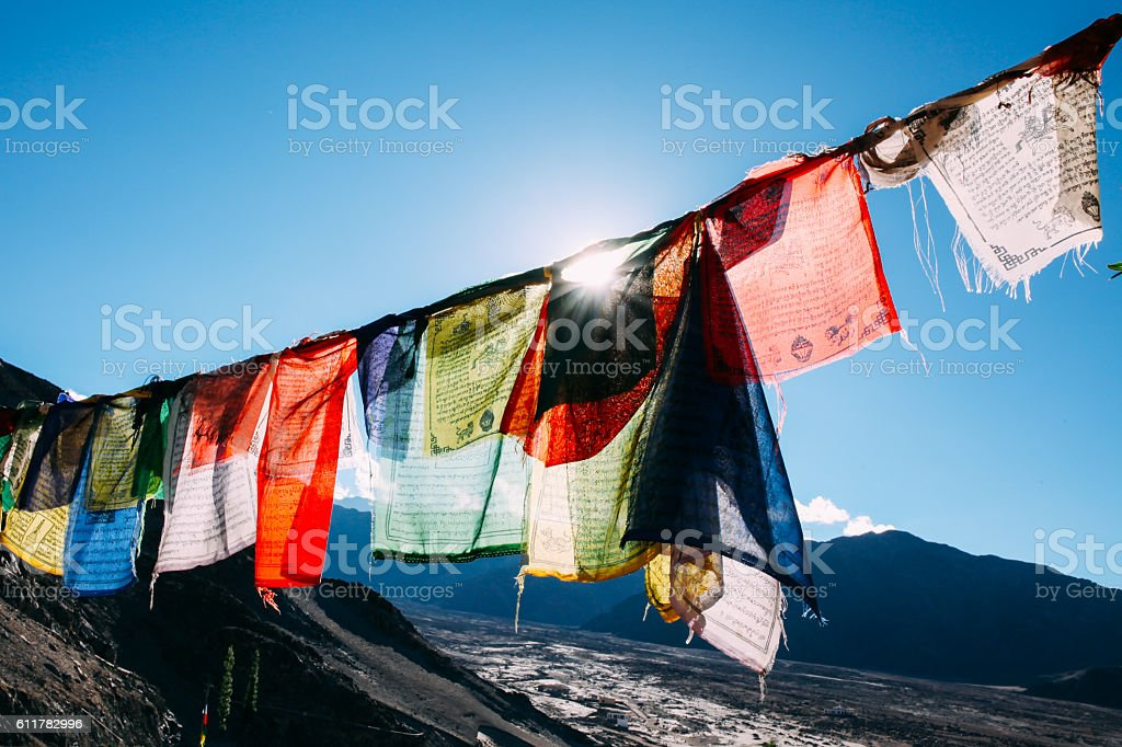 Colorful prayer flags with sun shining through prayer flags stock photo