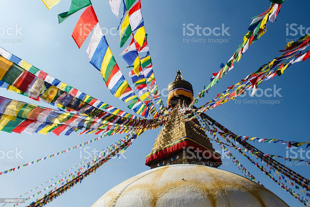 colorful praying flags and buddhist stupa in sunlight in nepal stock photo