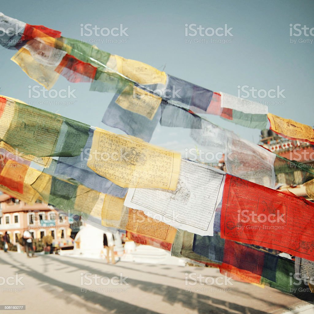 Colorful praying flags newr Boudhanath Stupa - vintage filter. stock photo