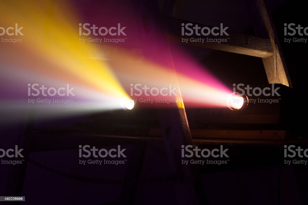 colorful projector lights stock photo