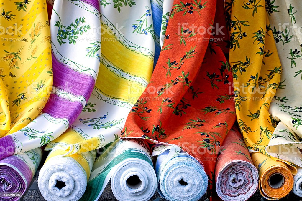 Colorful Provence fabric rolled up together royalty-free stock photo