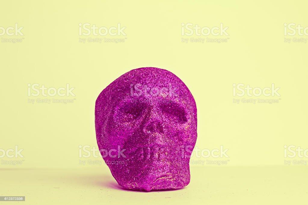 Colorful Purple Halloween Skull on Yellow Background stock photo