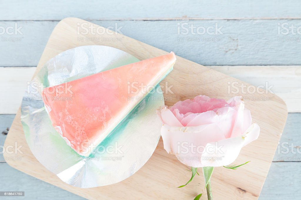 colorful rainbow cake on wooden plate vintage wood background stock photo