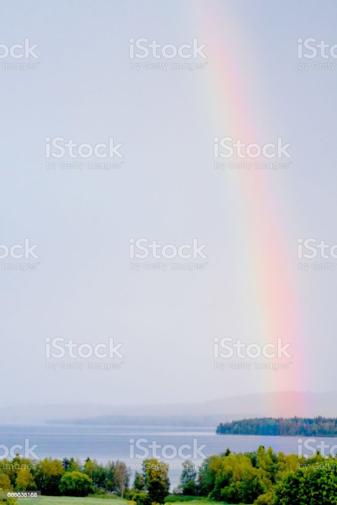 Colorful rainbow over lake stock photo
