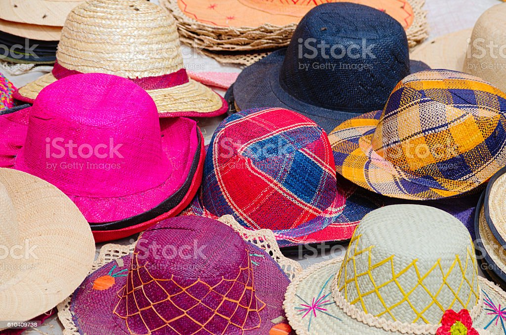Colorful raphia hat on the street market in Madagascar stock photo